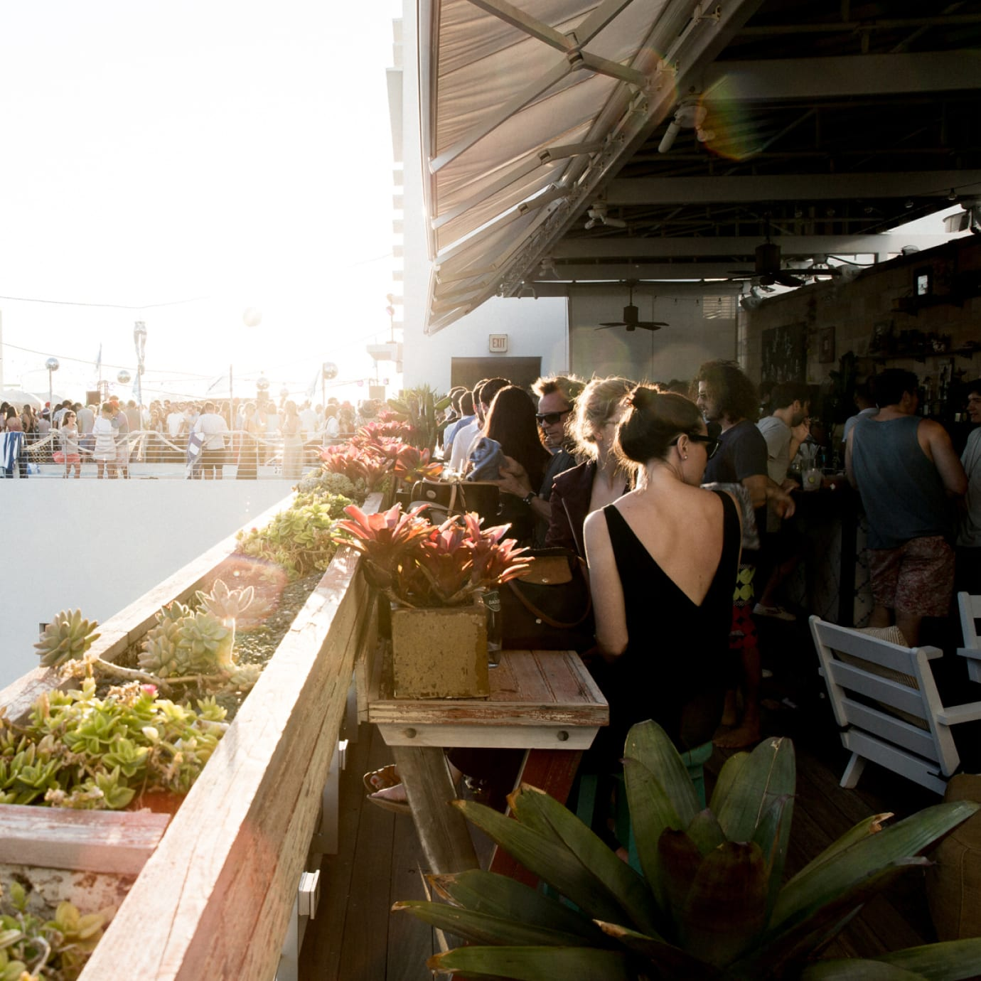 A busy rooftop bar.