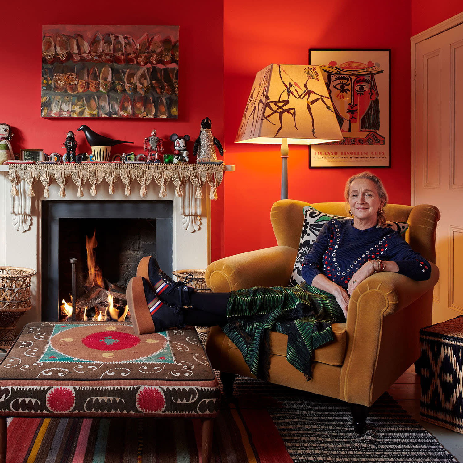 Lucinda Chambers sat on her armchair next to the fire