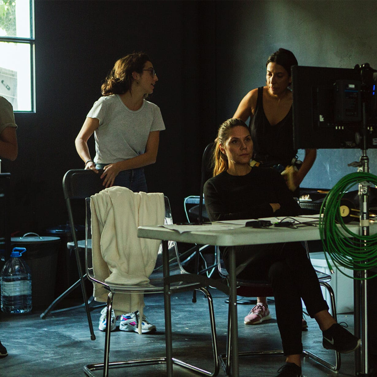 group of women behind directing table with camera equipment