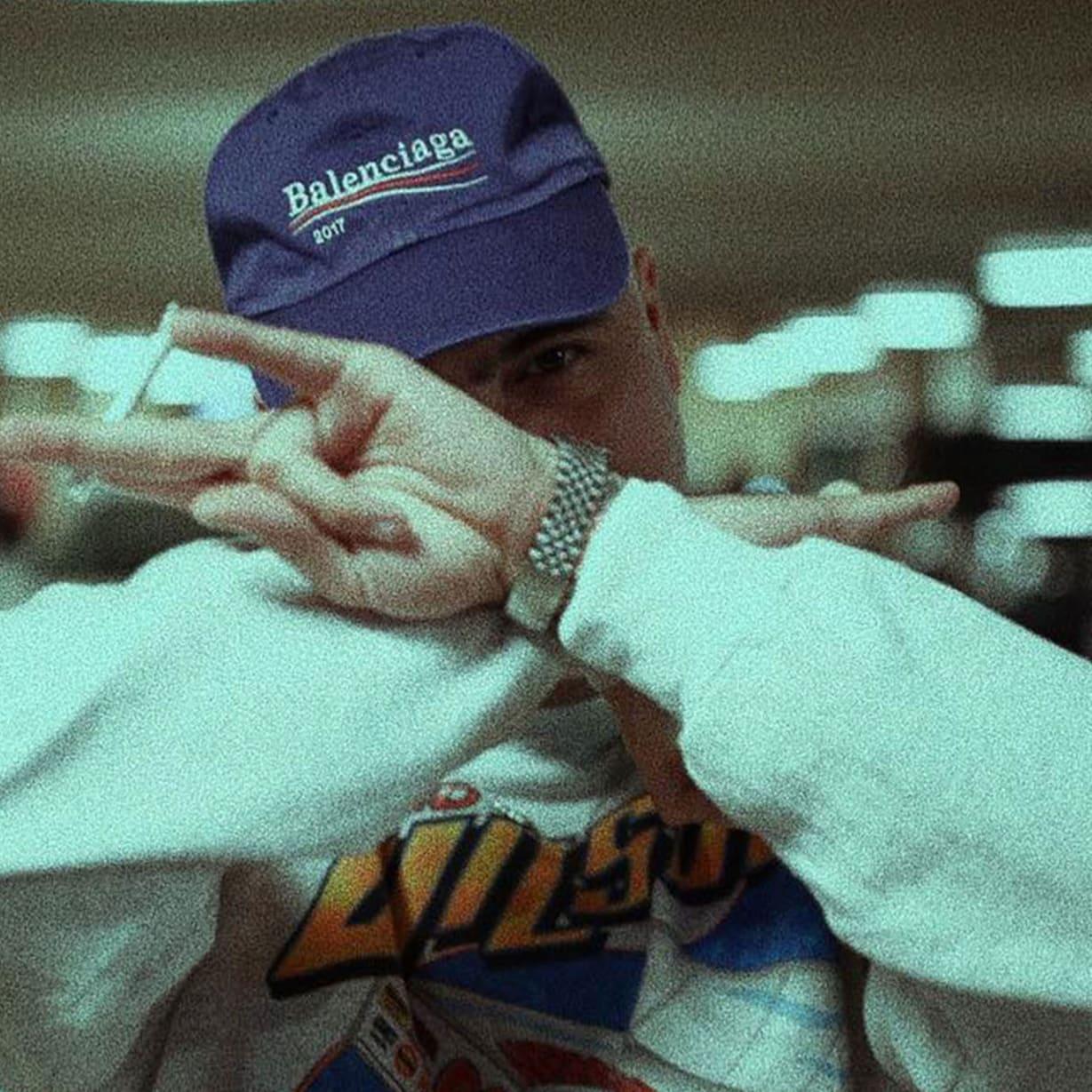 man in sweatshirt and cap in parking lot