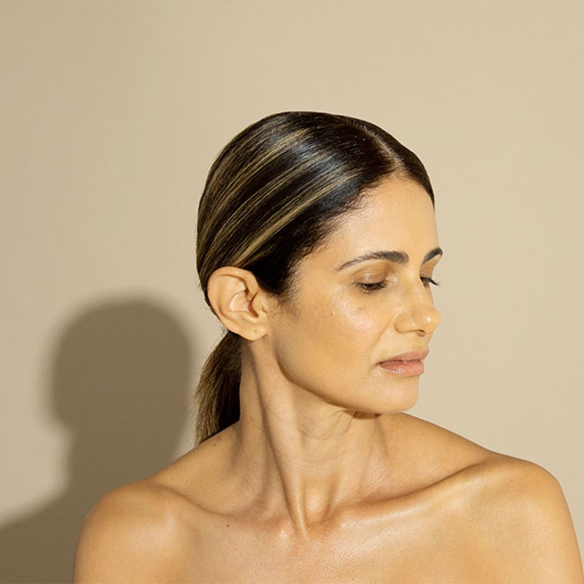 Woman bare shoulders and chest head turned to side