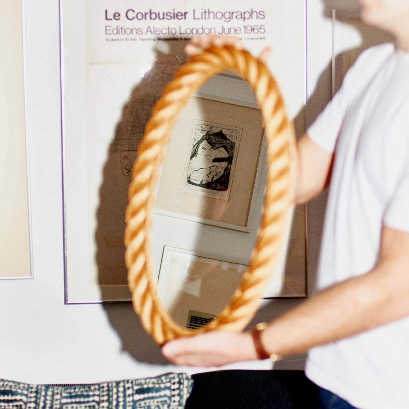 A man holding a mirror.