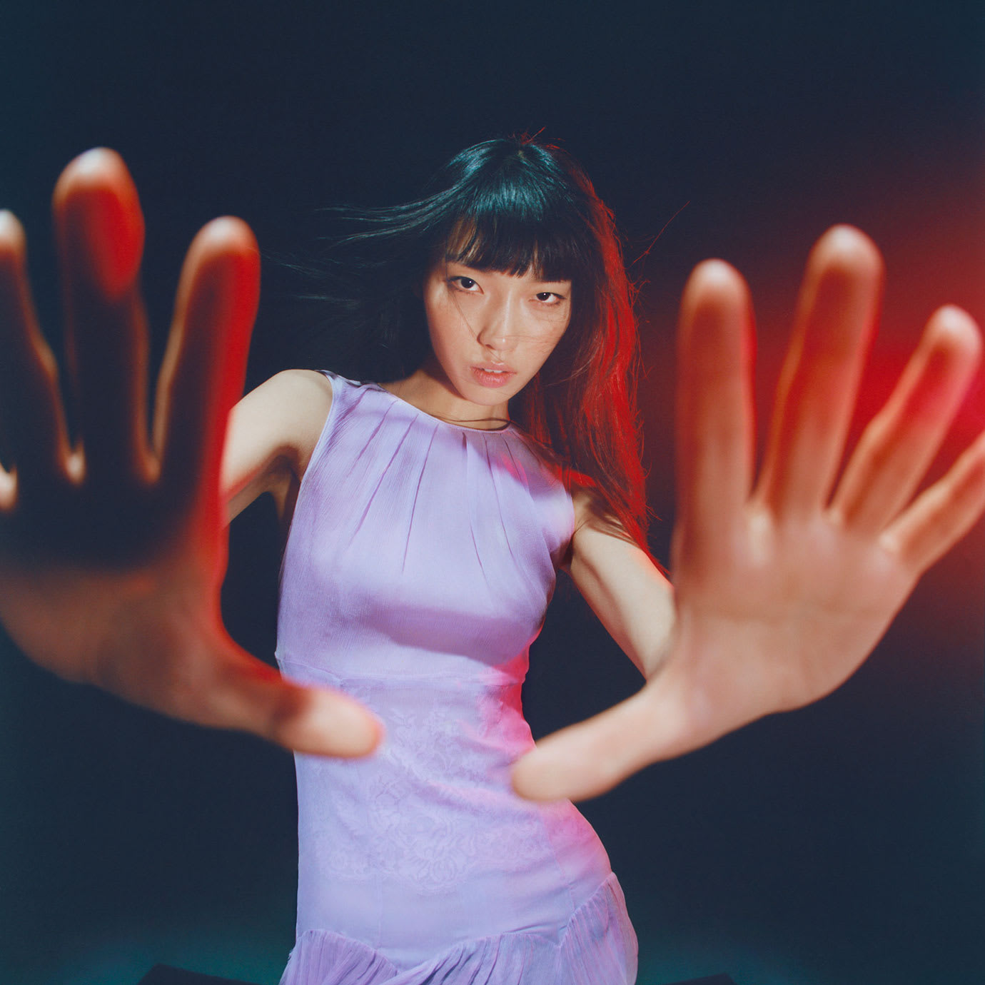 A woman with her hands out towards the camera.