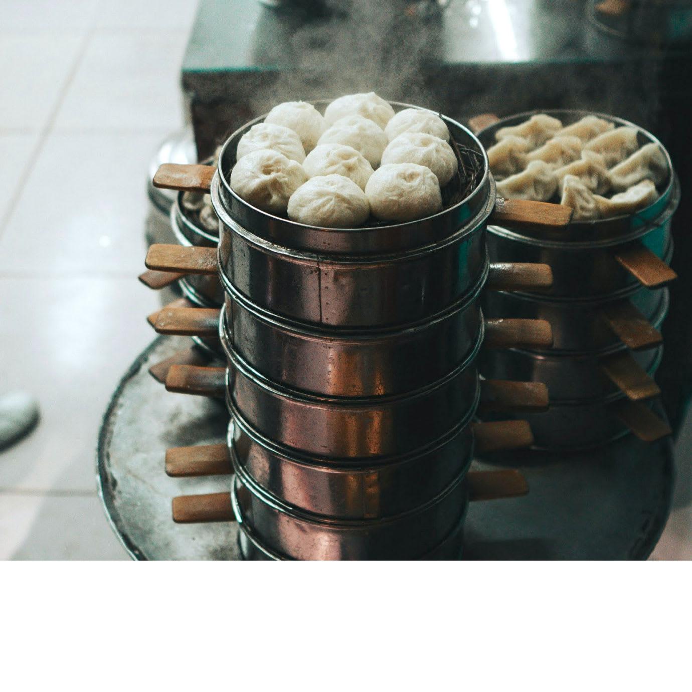 Dim sum dumplings on trays.