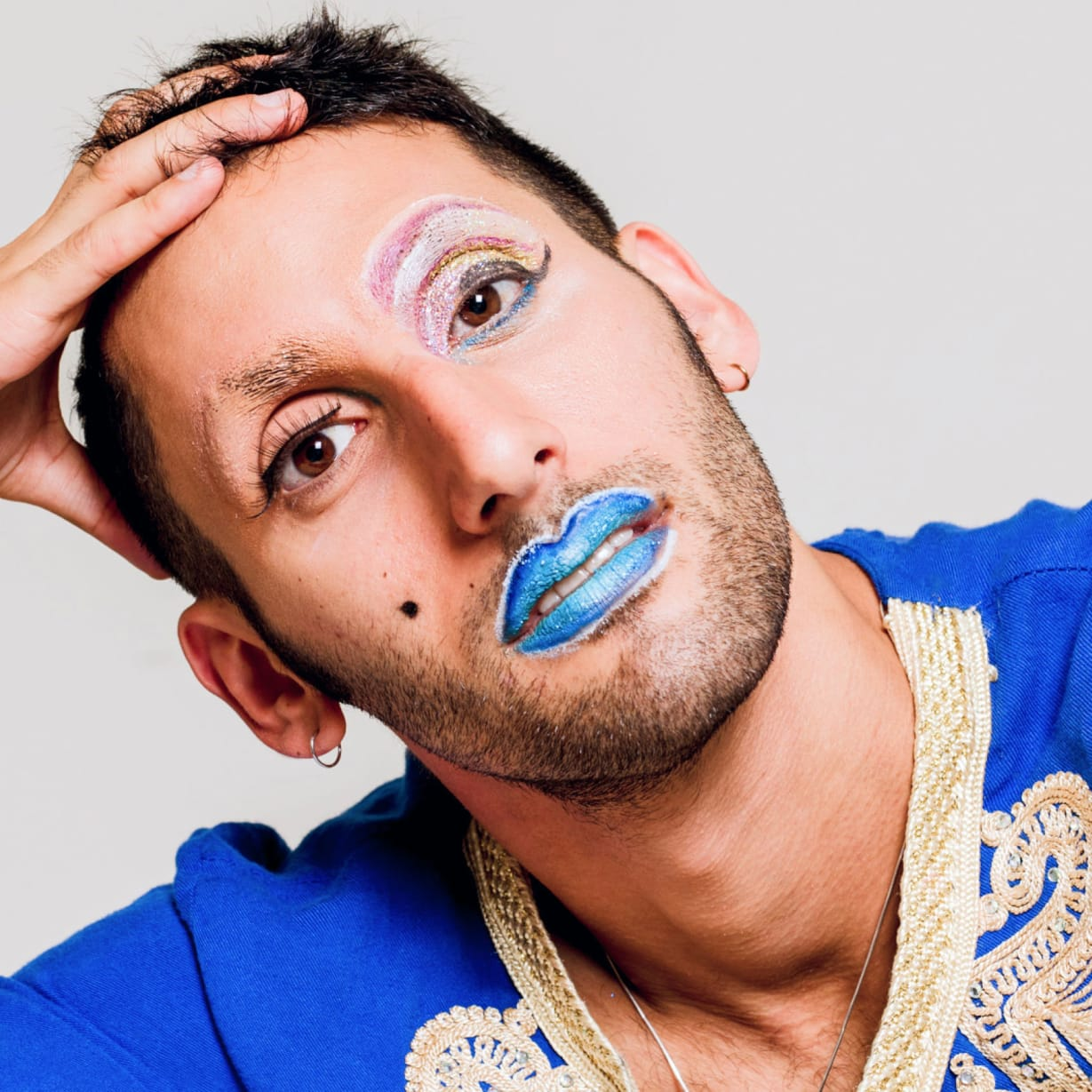 A man wearing blue lipstick.