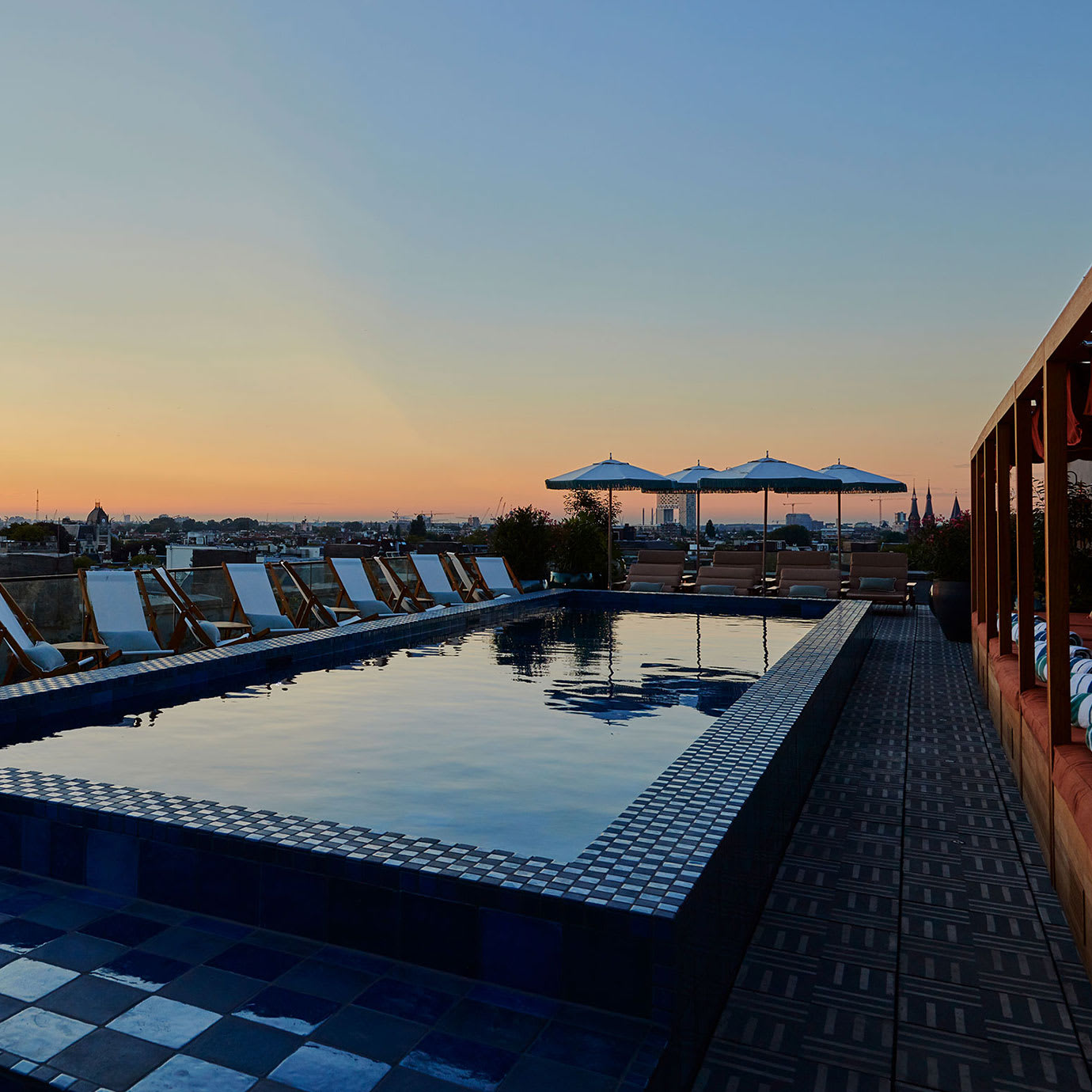 A rooftop pool at sunset.