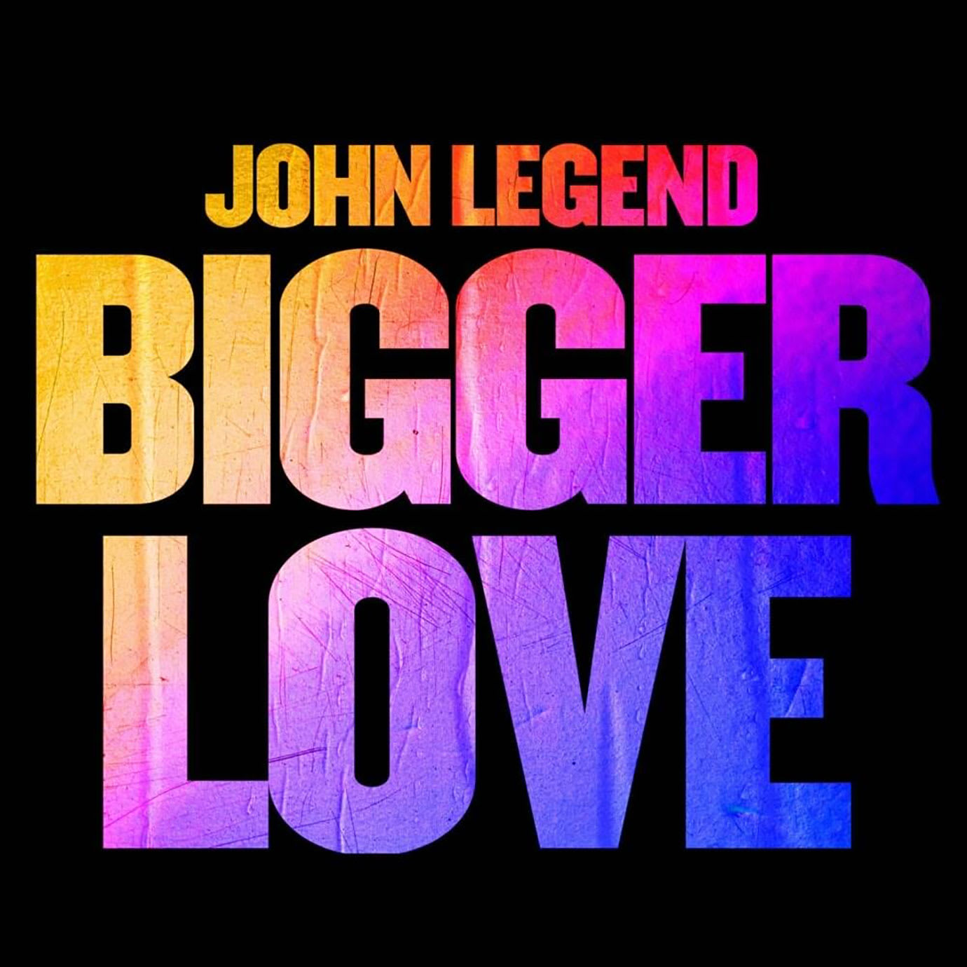 An album cover with John Legend Bigger Love written on it in colourful type.