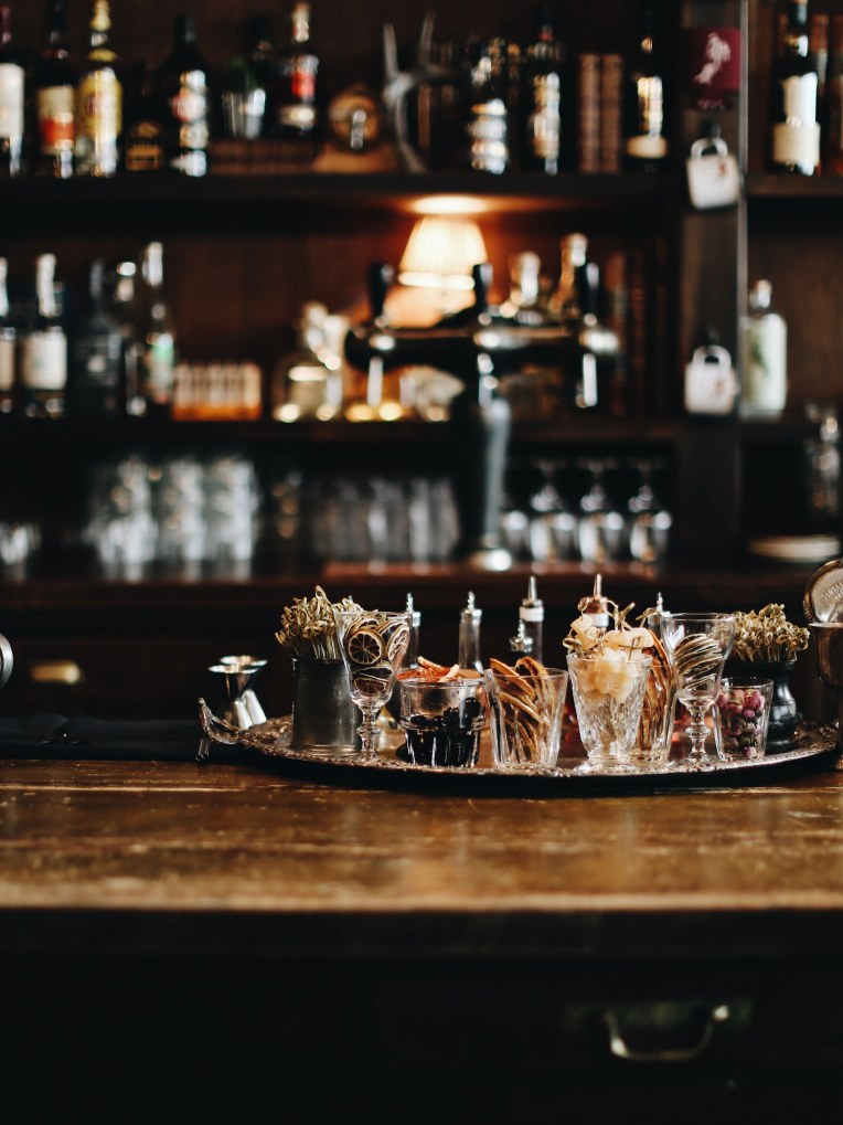 A bar with cocktail garnishes in glasses on it.