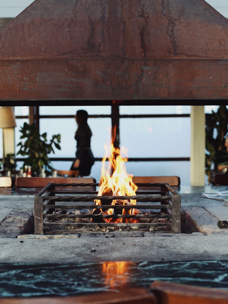 An open fire and grill in a restaurant.