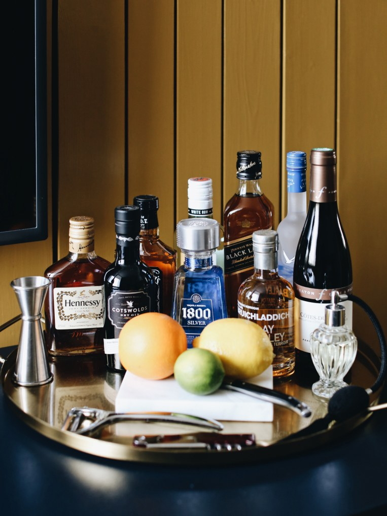 A drinks tray with cocktail paraphanalia on it.