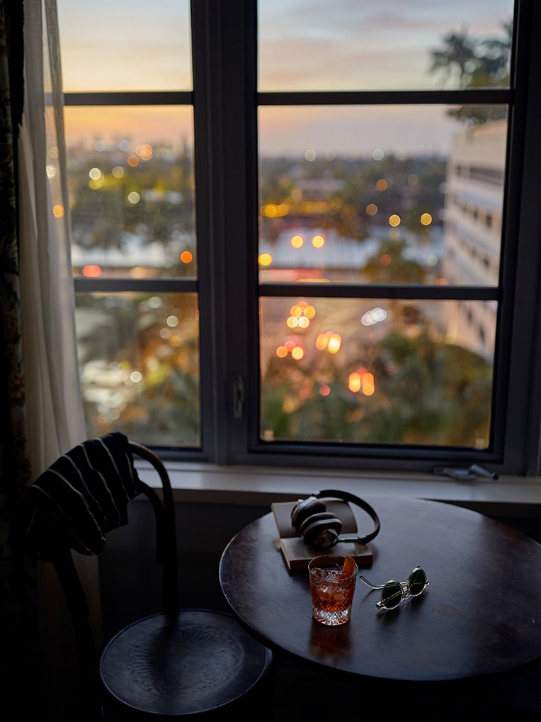 A view out of a window at sunset.