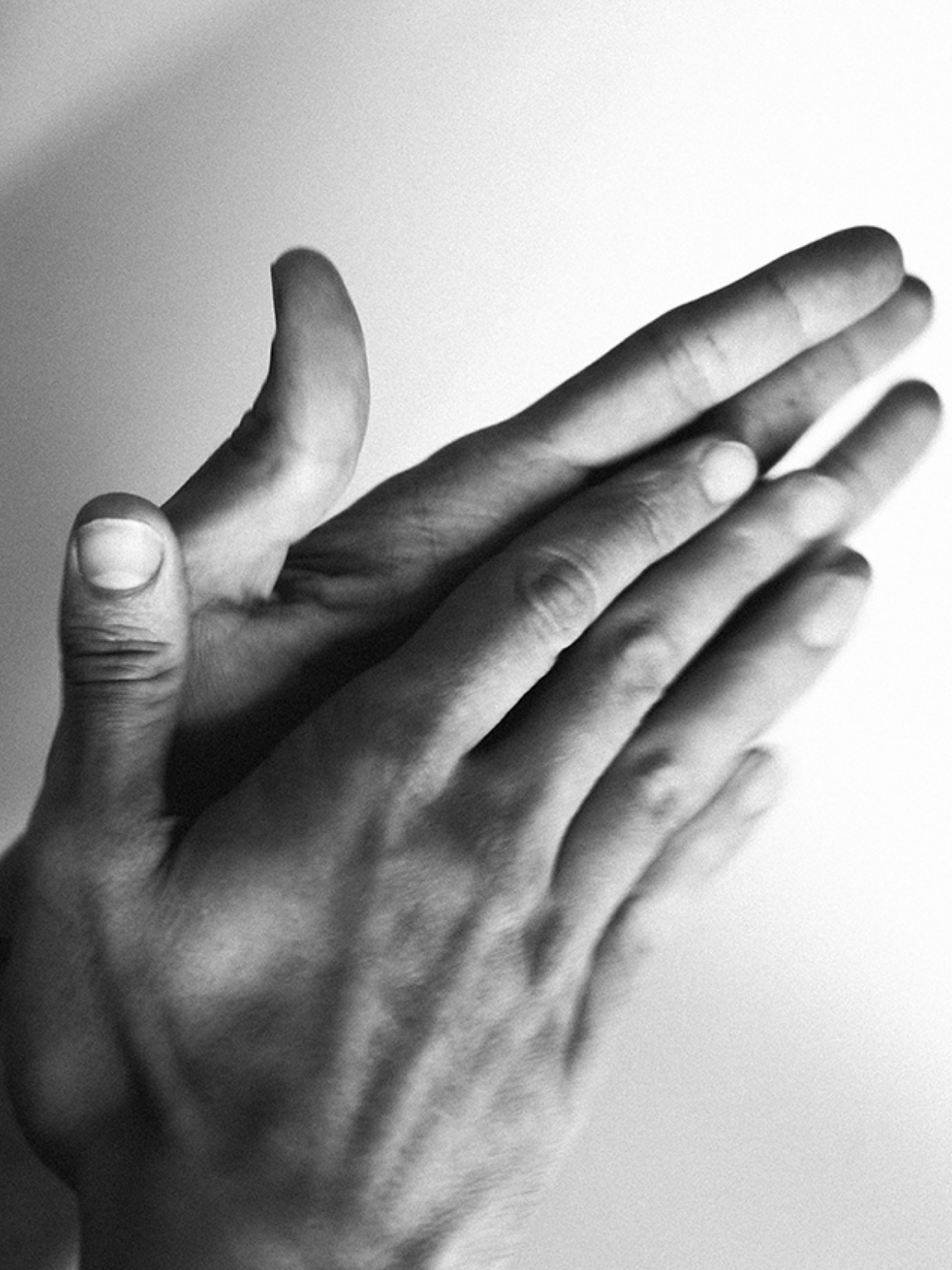Black and white hands gesticulating.