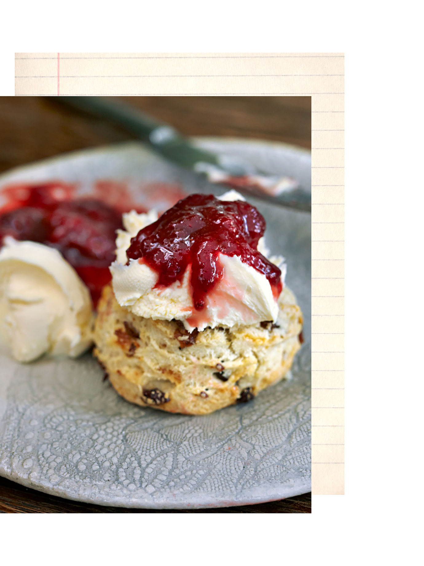 A scone with jam on it.