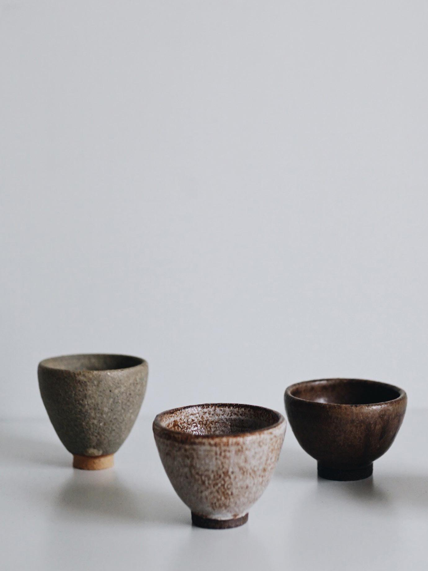 Three bowls on a grey background.