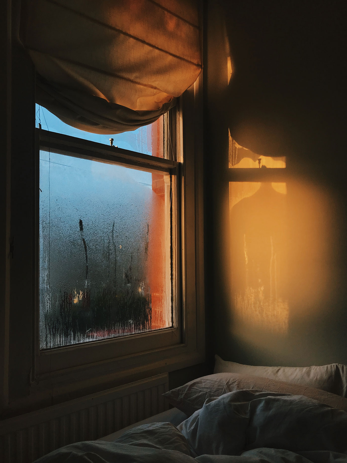 A bedroom window with dawn light.