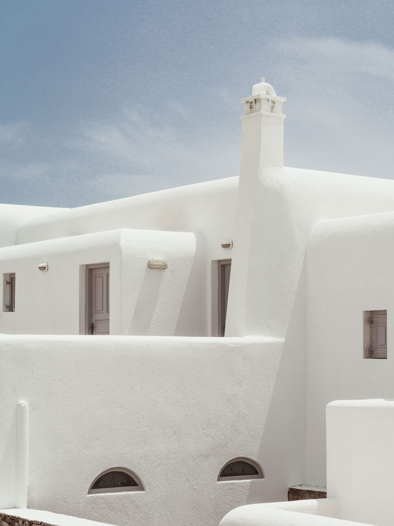 White stucco buildings under a blue sky.