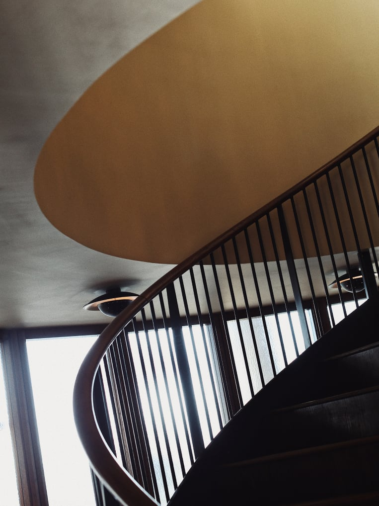 A spiral staircase stairwell.