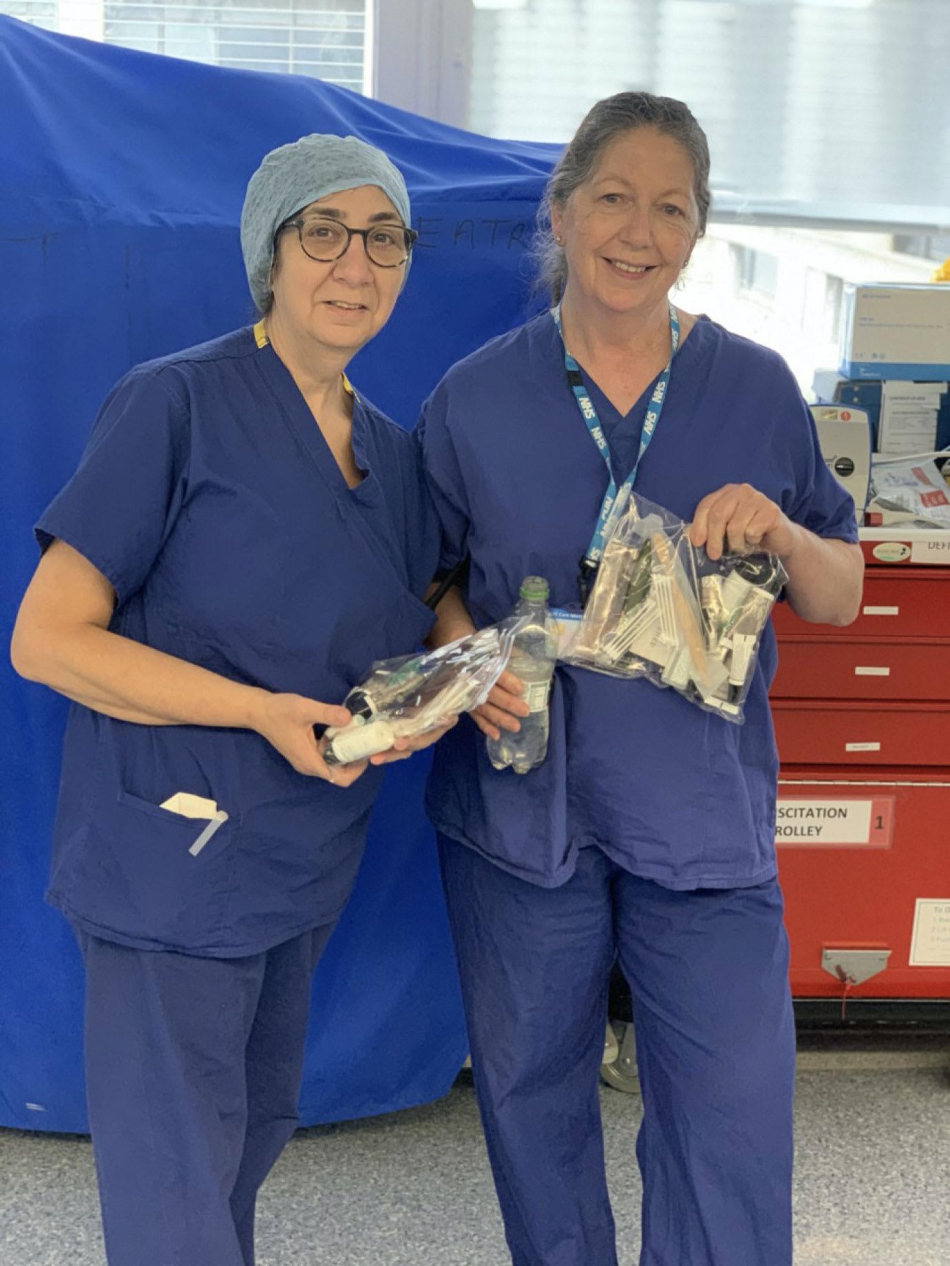 Two nurses in blue uniforms.