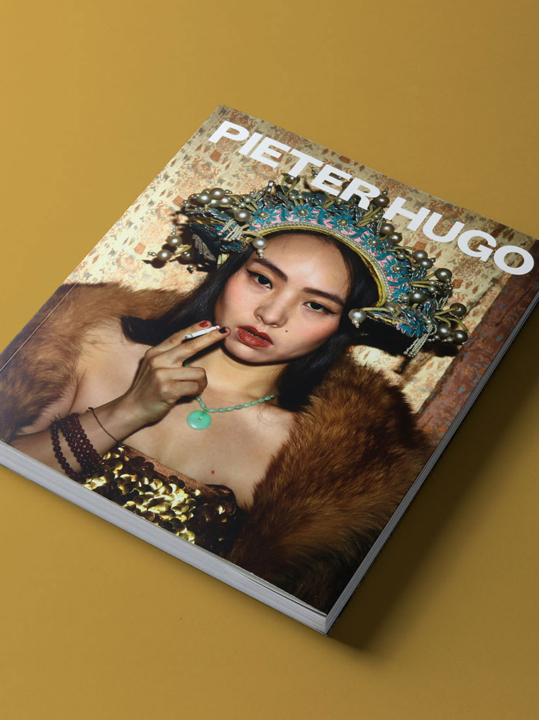 A photography book with a model on the cover.