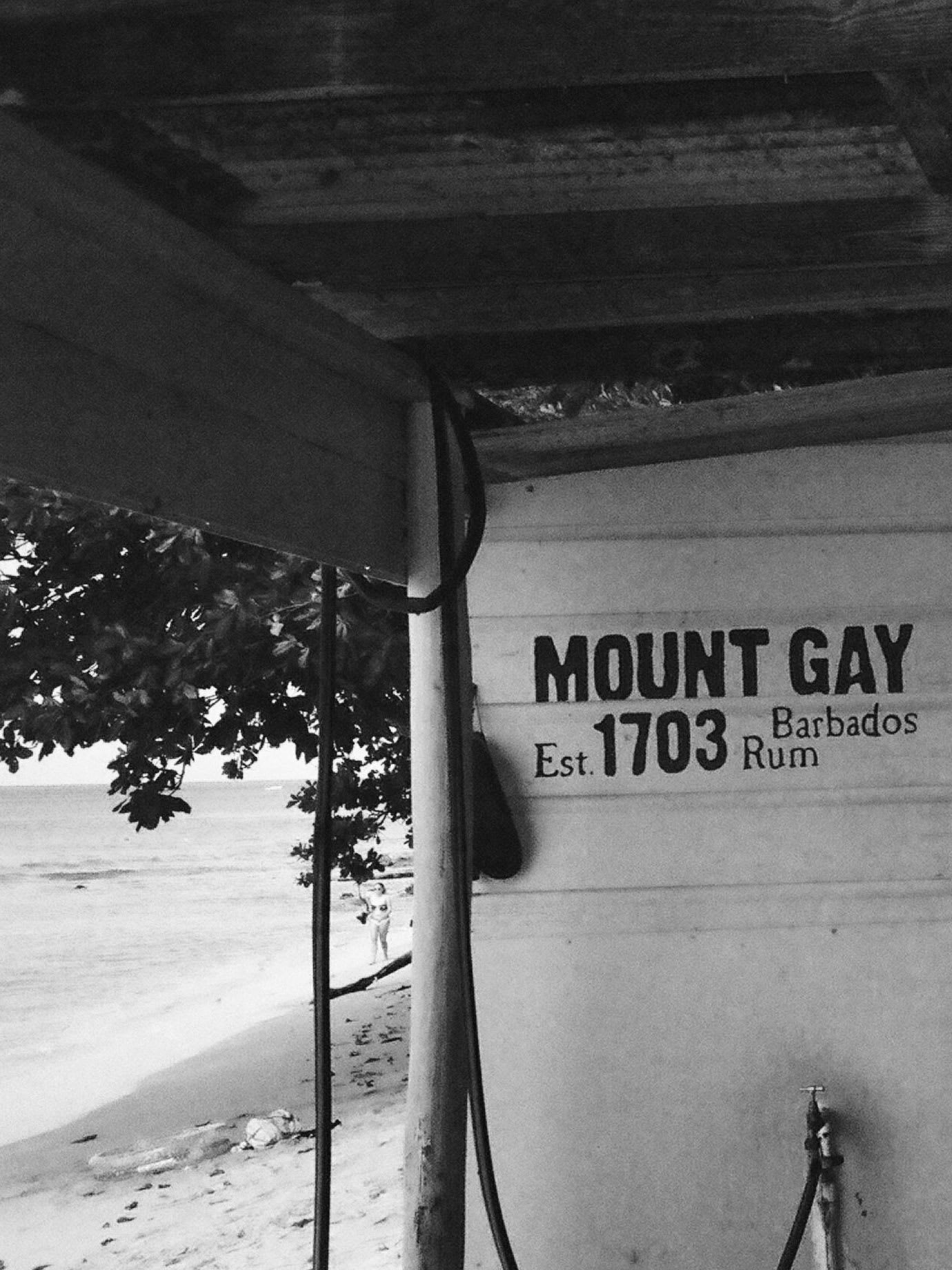 A bar with Mount Gay written on its wall.
