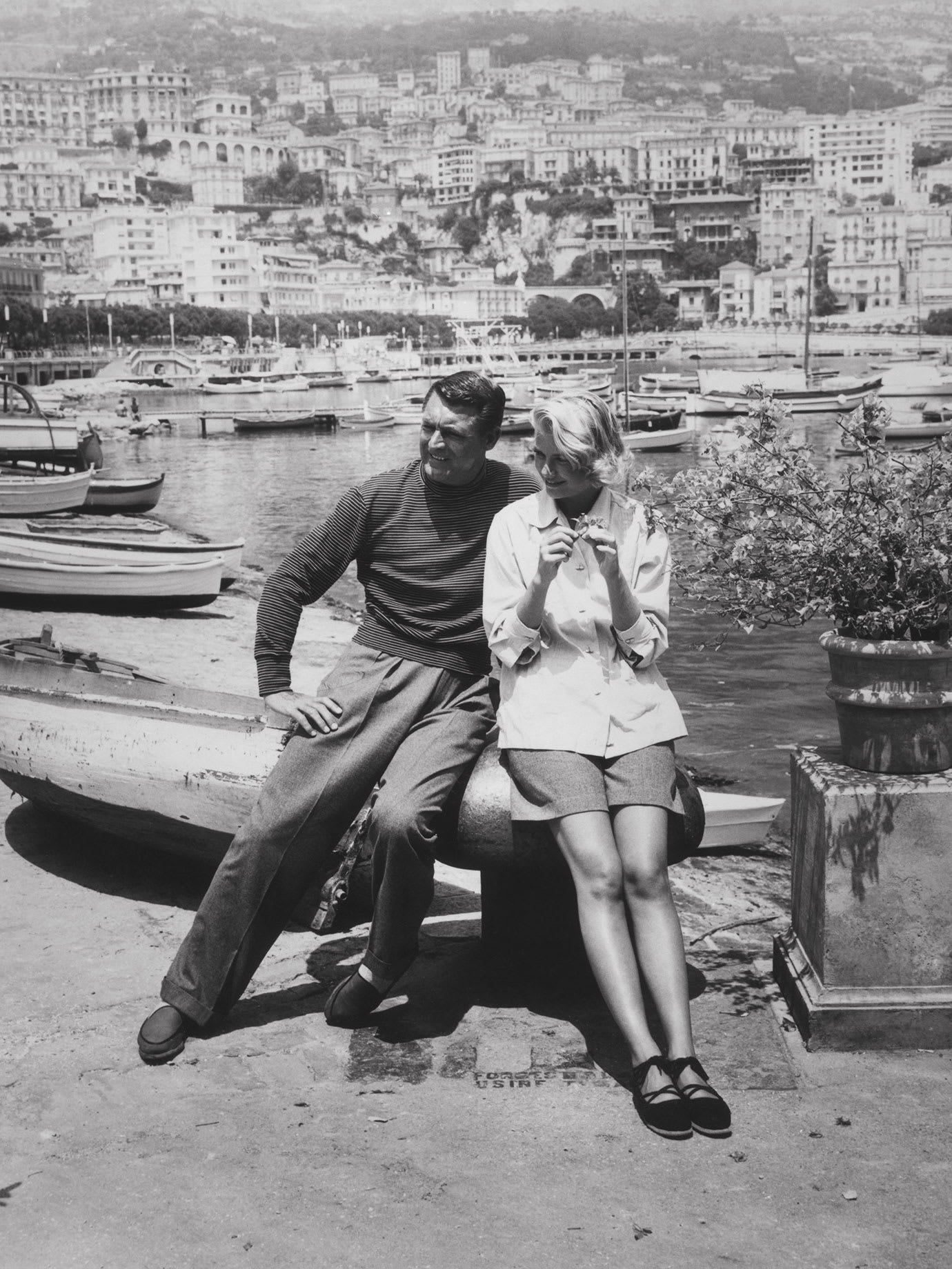 A vintage photograph of a man and a woman overlooking the french riviera.