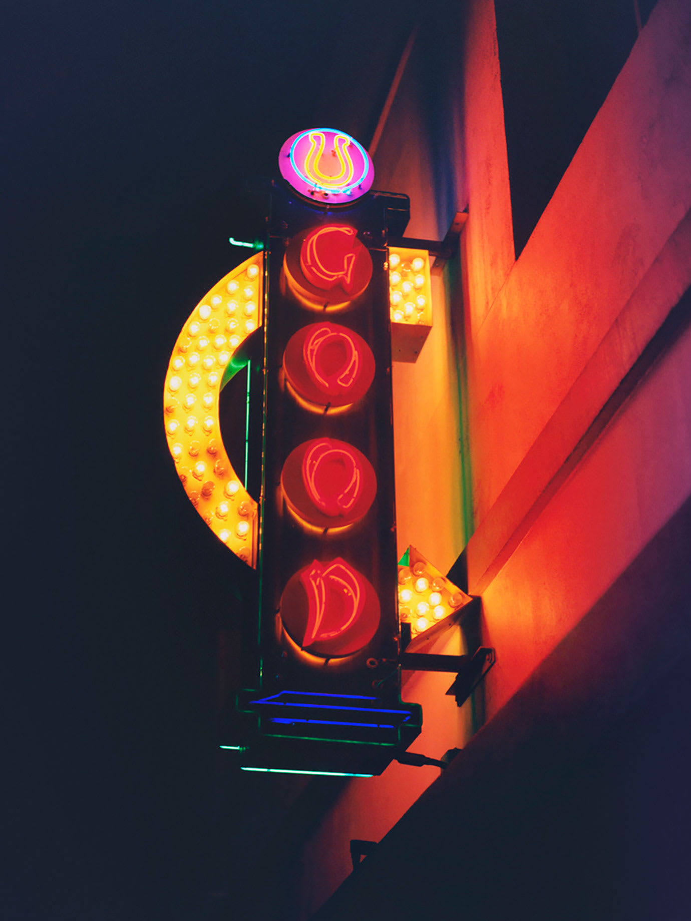 A neon sign with Good written on it.