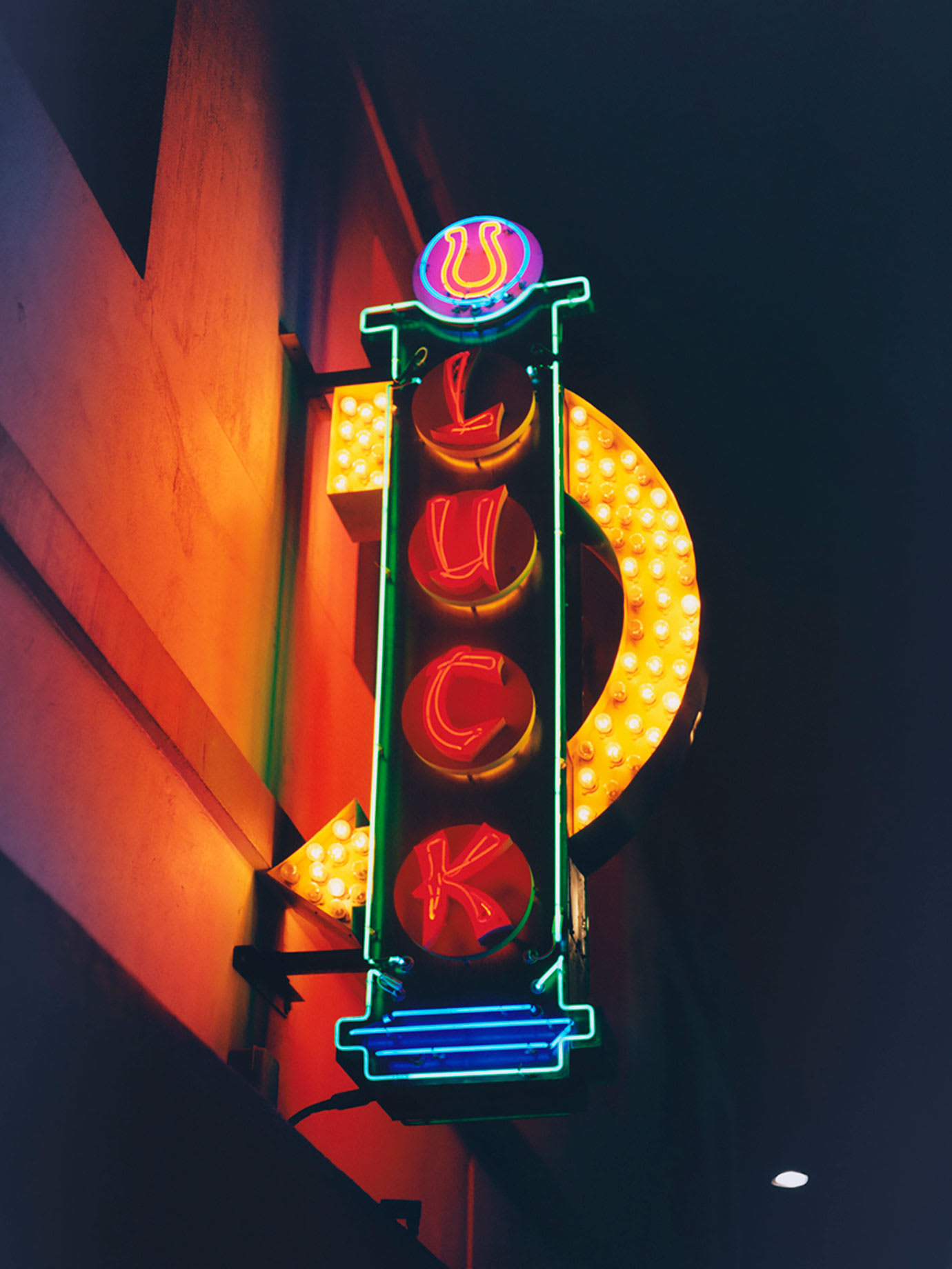 A neon sign with Luck written on it.