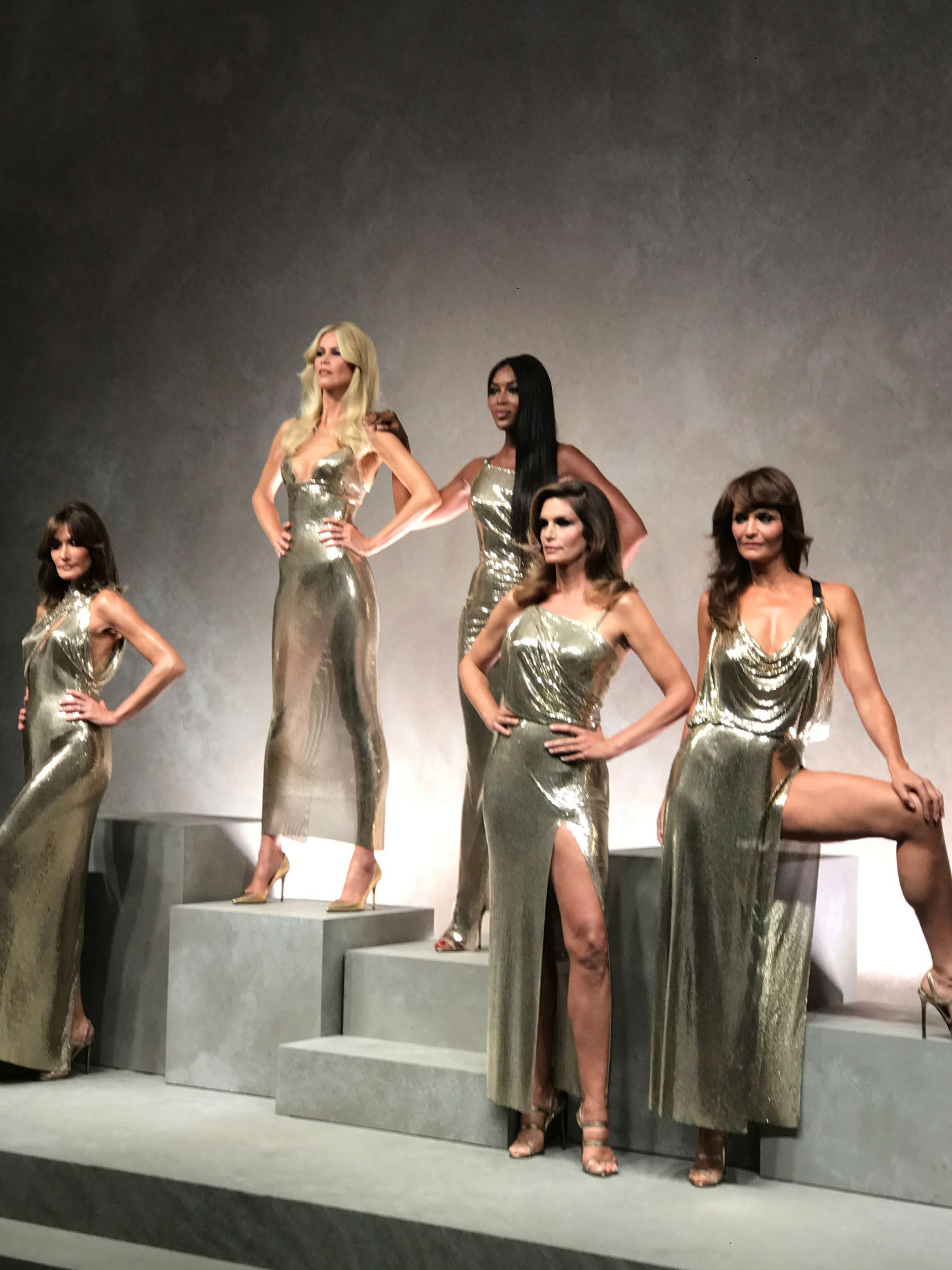 Five models standing on a stage.