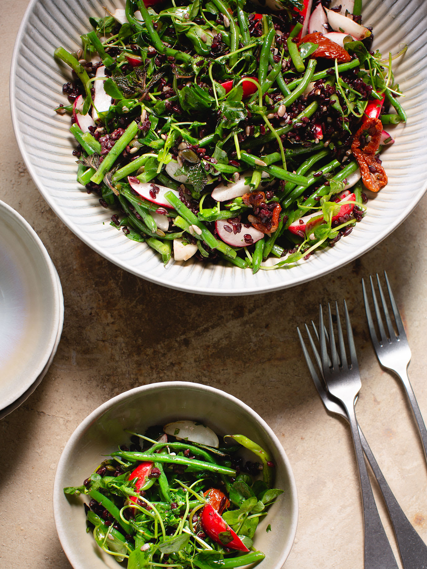 Two bowls of green salad.