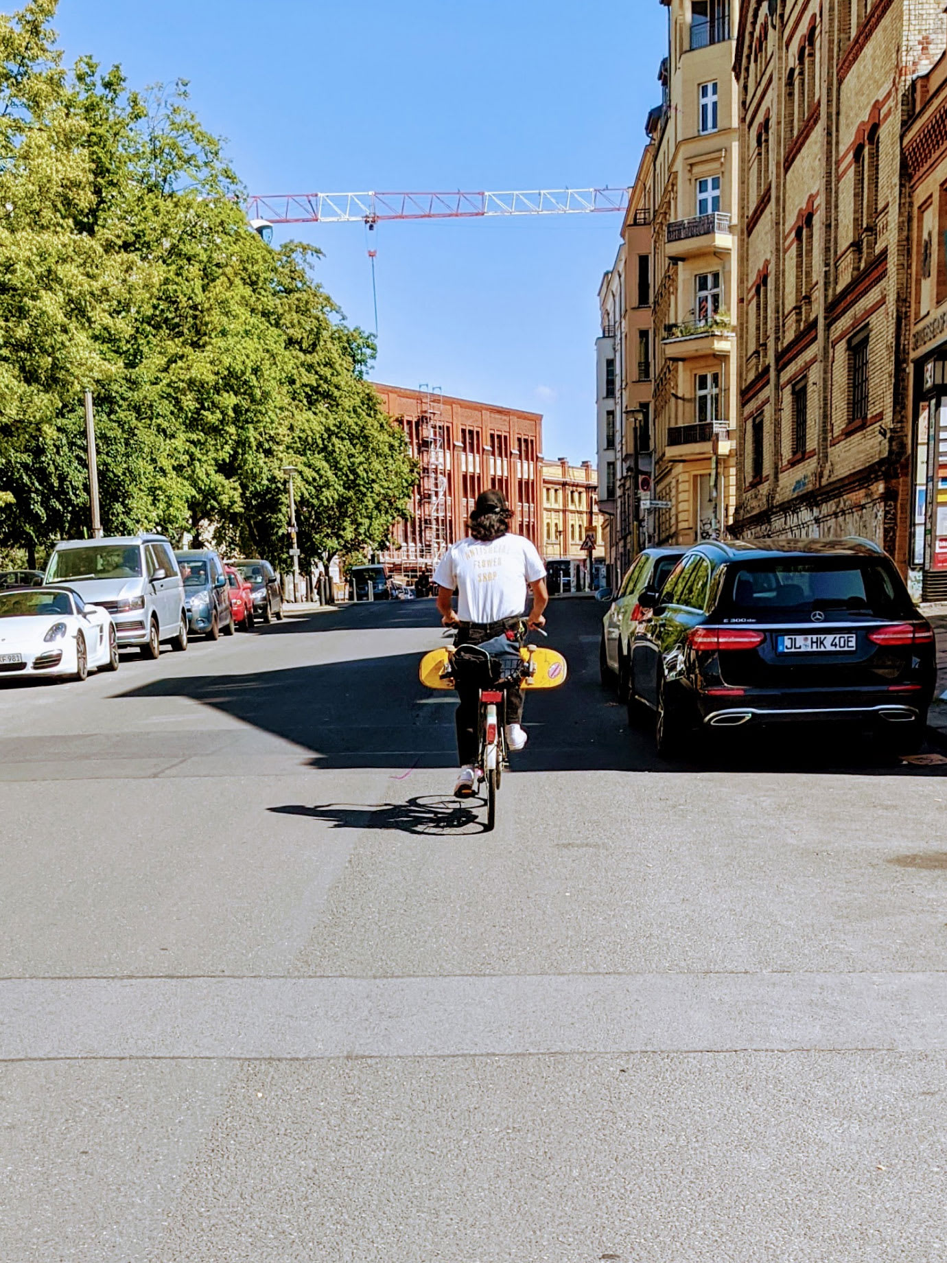 A man cycling down a city street.