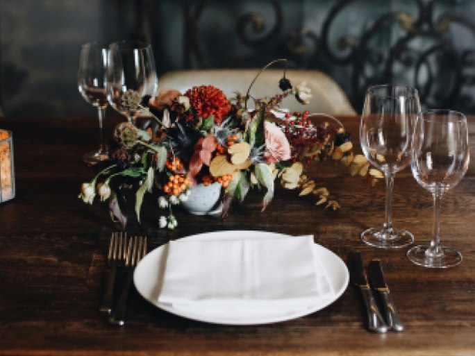 A dining table laid for dinner.
