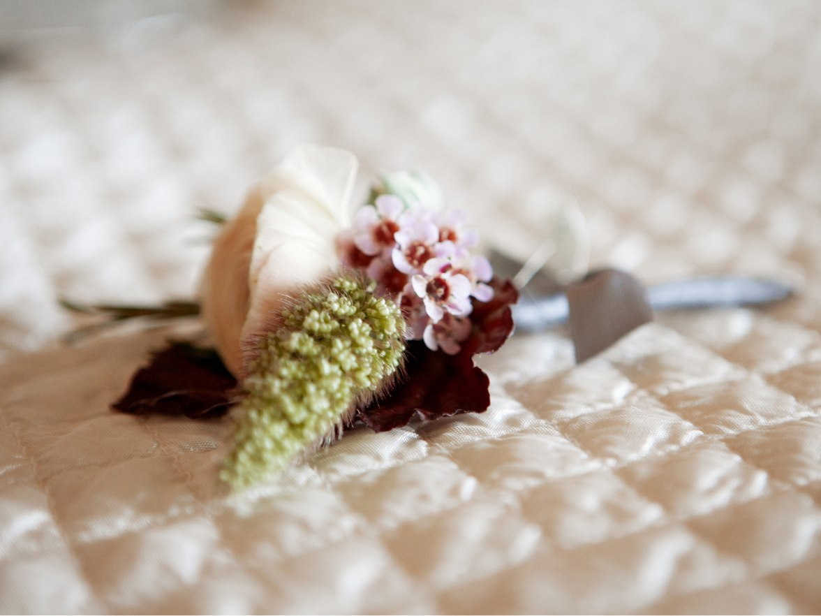 A wedding bouquet on a bed.