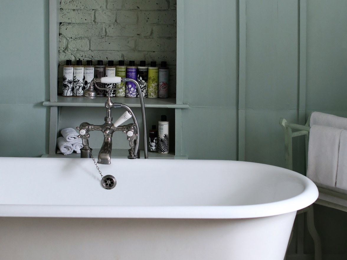 A roll top bath in a bedroom.