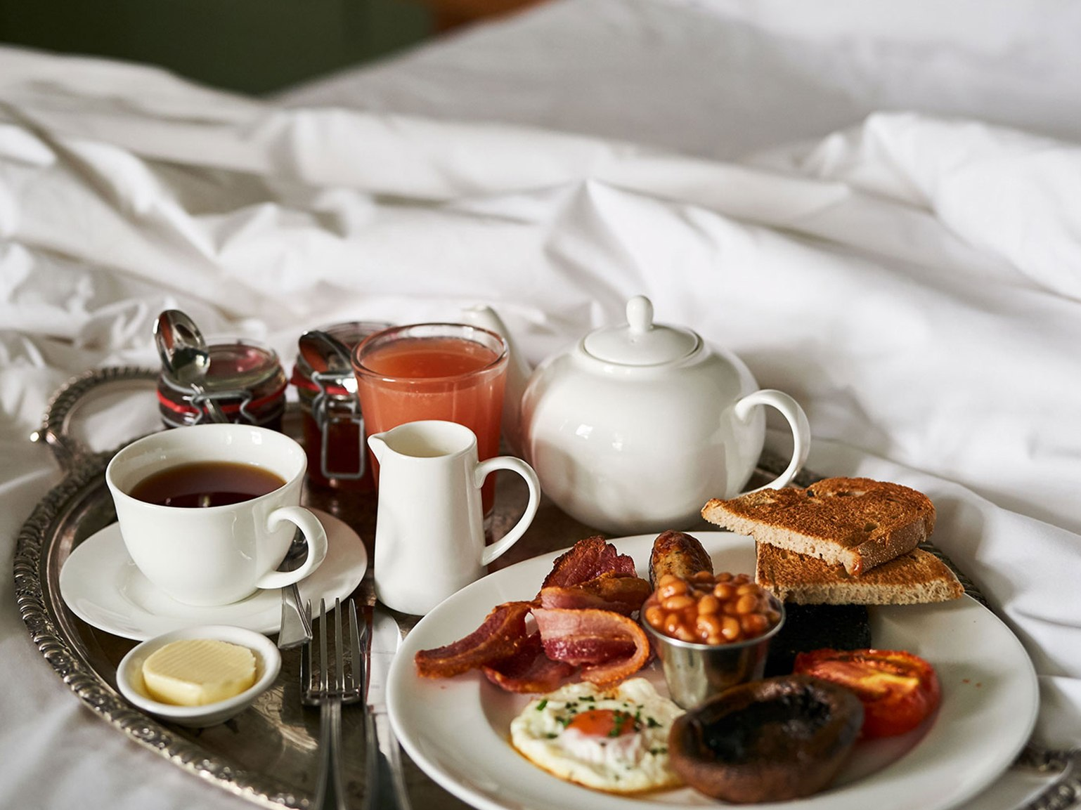 A breakfast tray on a bed.