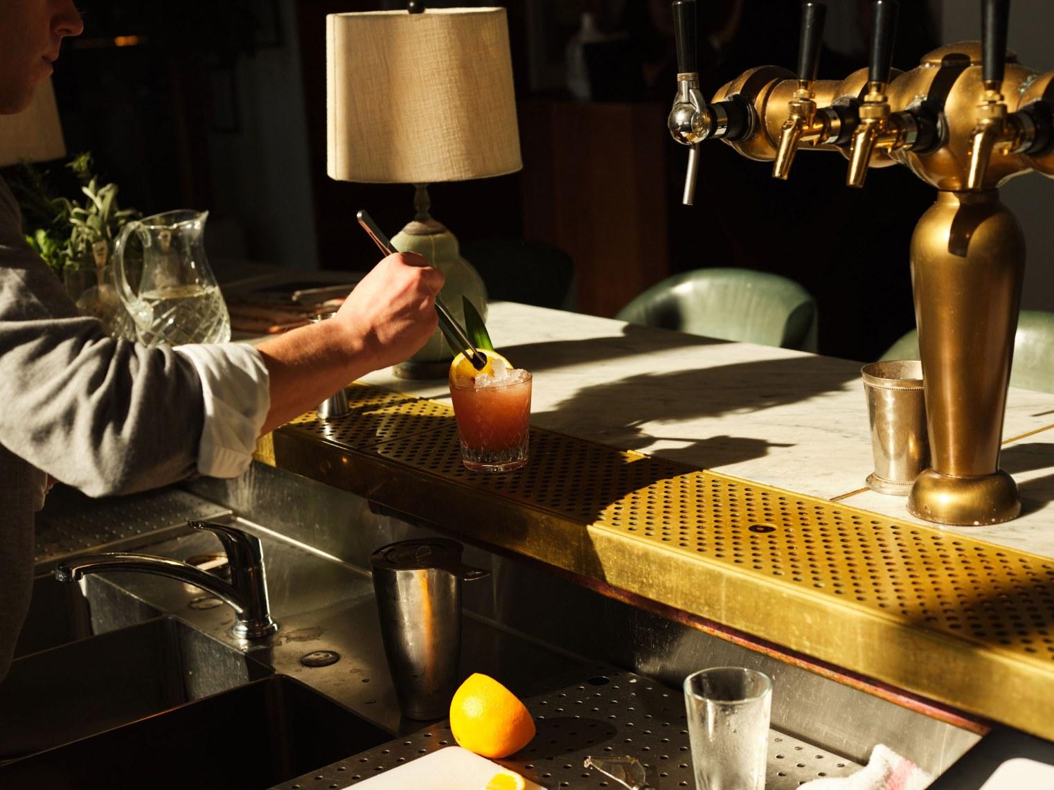 A barman preparing a cocktail.