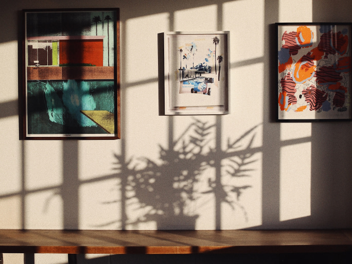 Artworks hung on a wall.