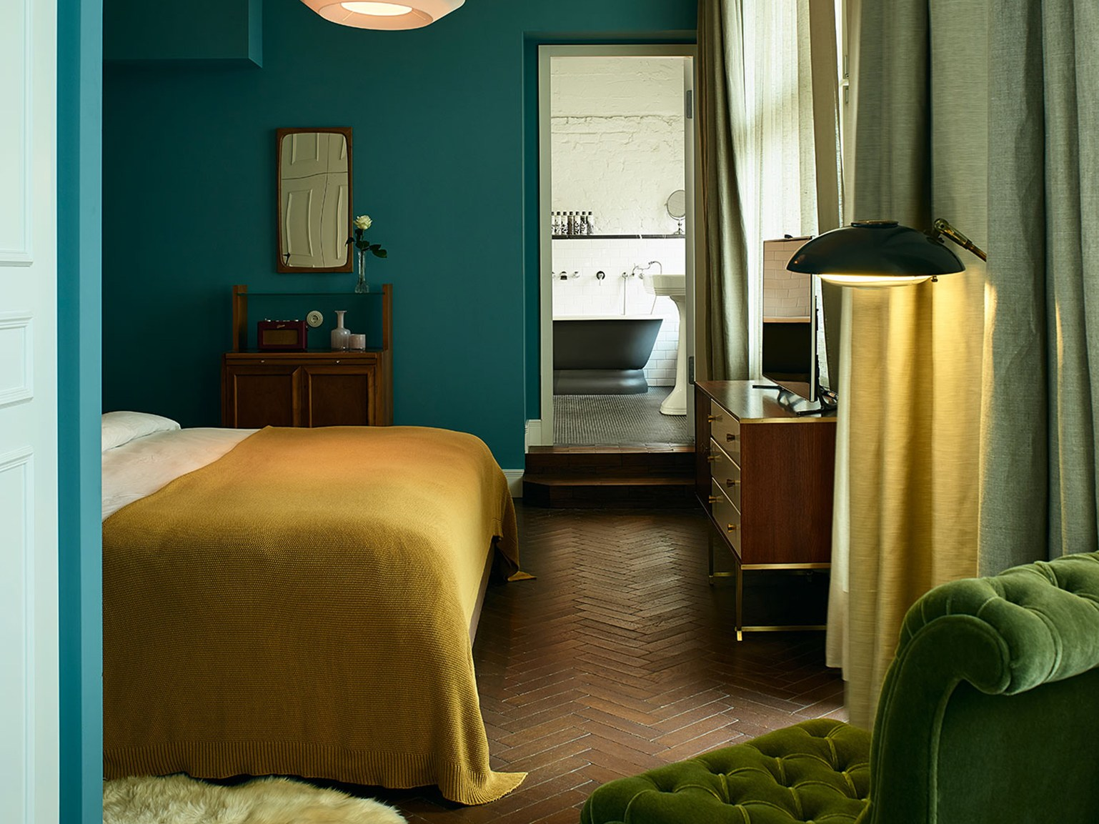 A bedroom with blue walls.