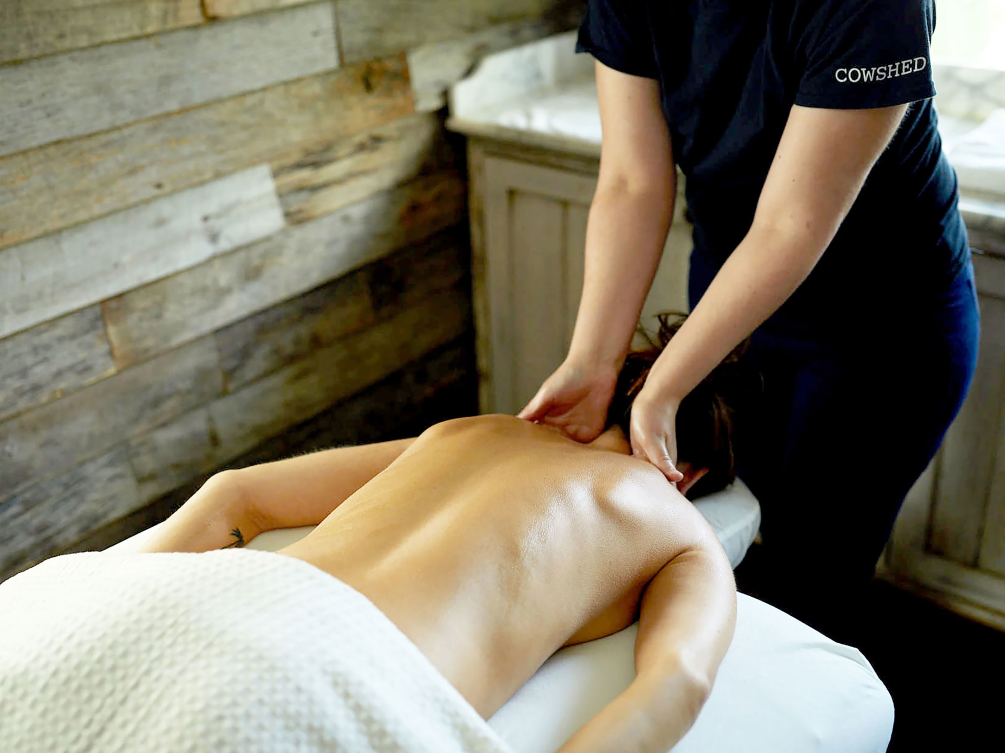 A woman receiving a massage in a spa.