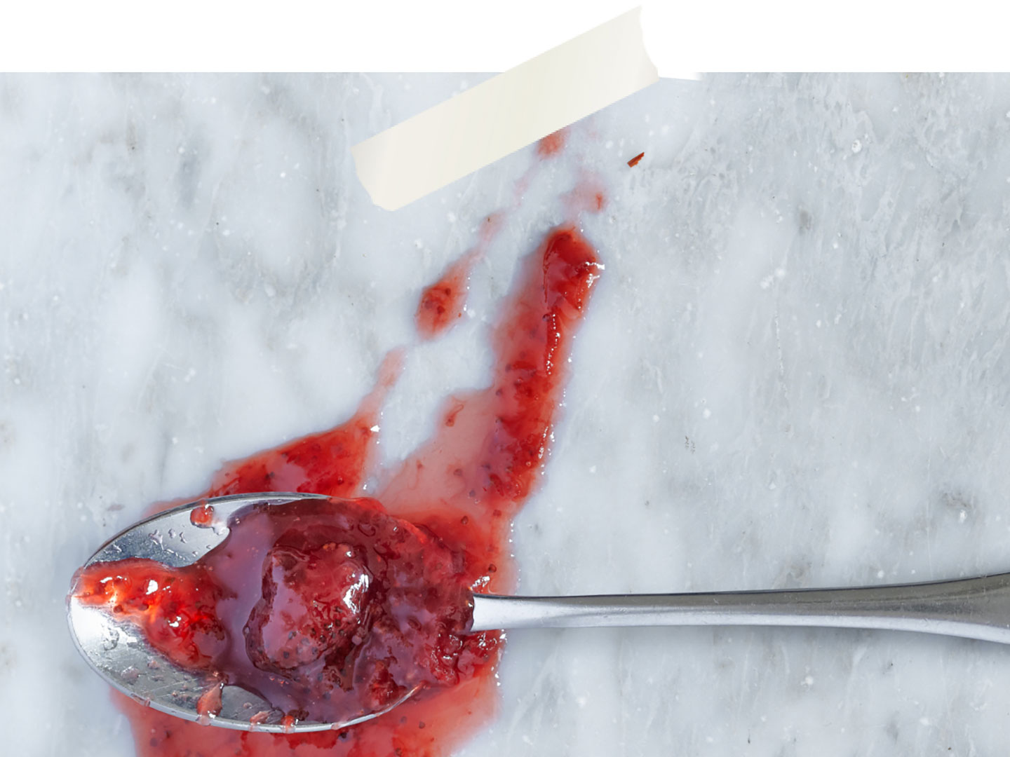 A spoon with jam on it.