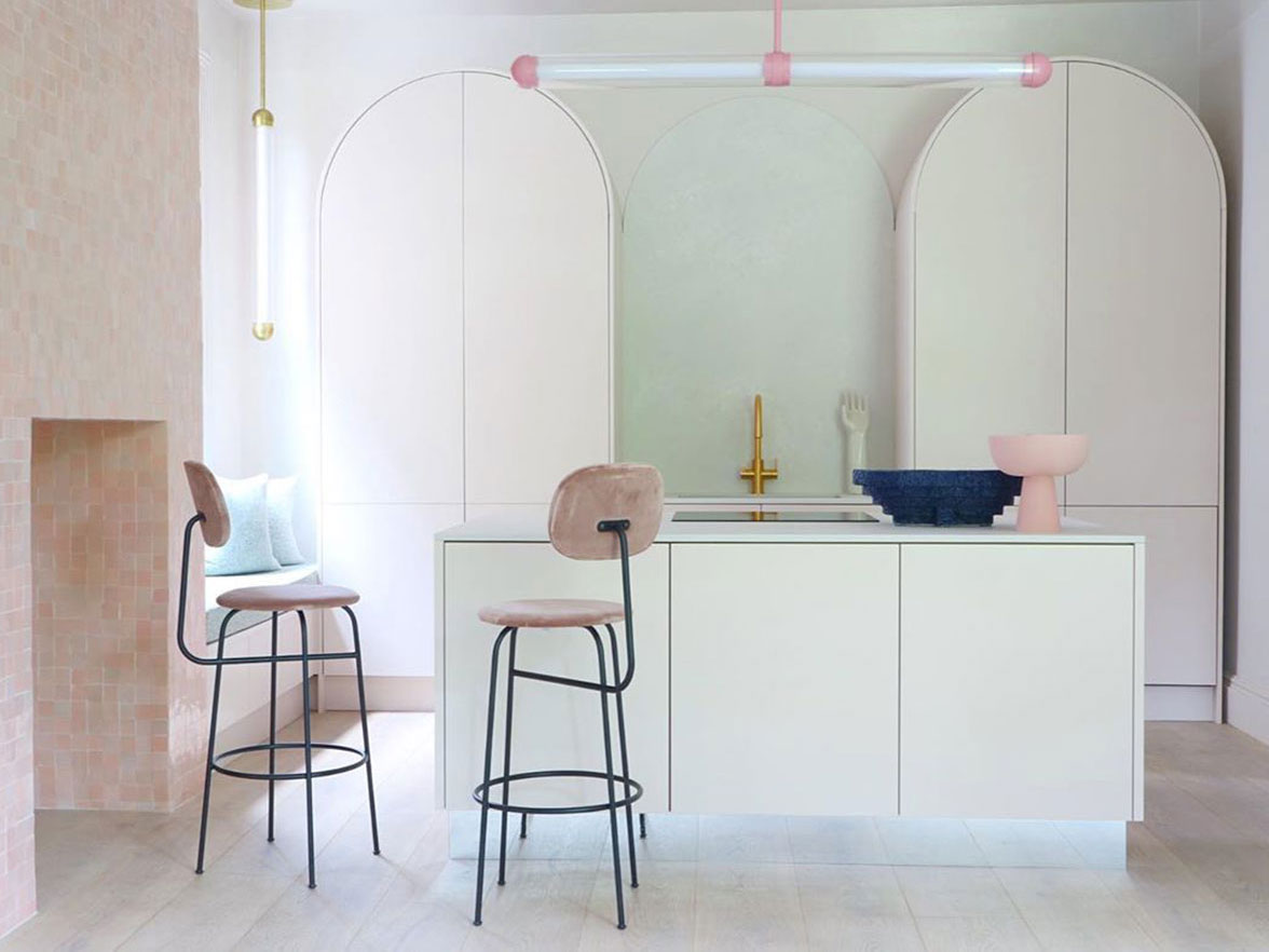 A kitchen in muted pastel colours.