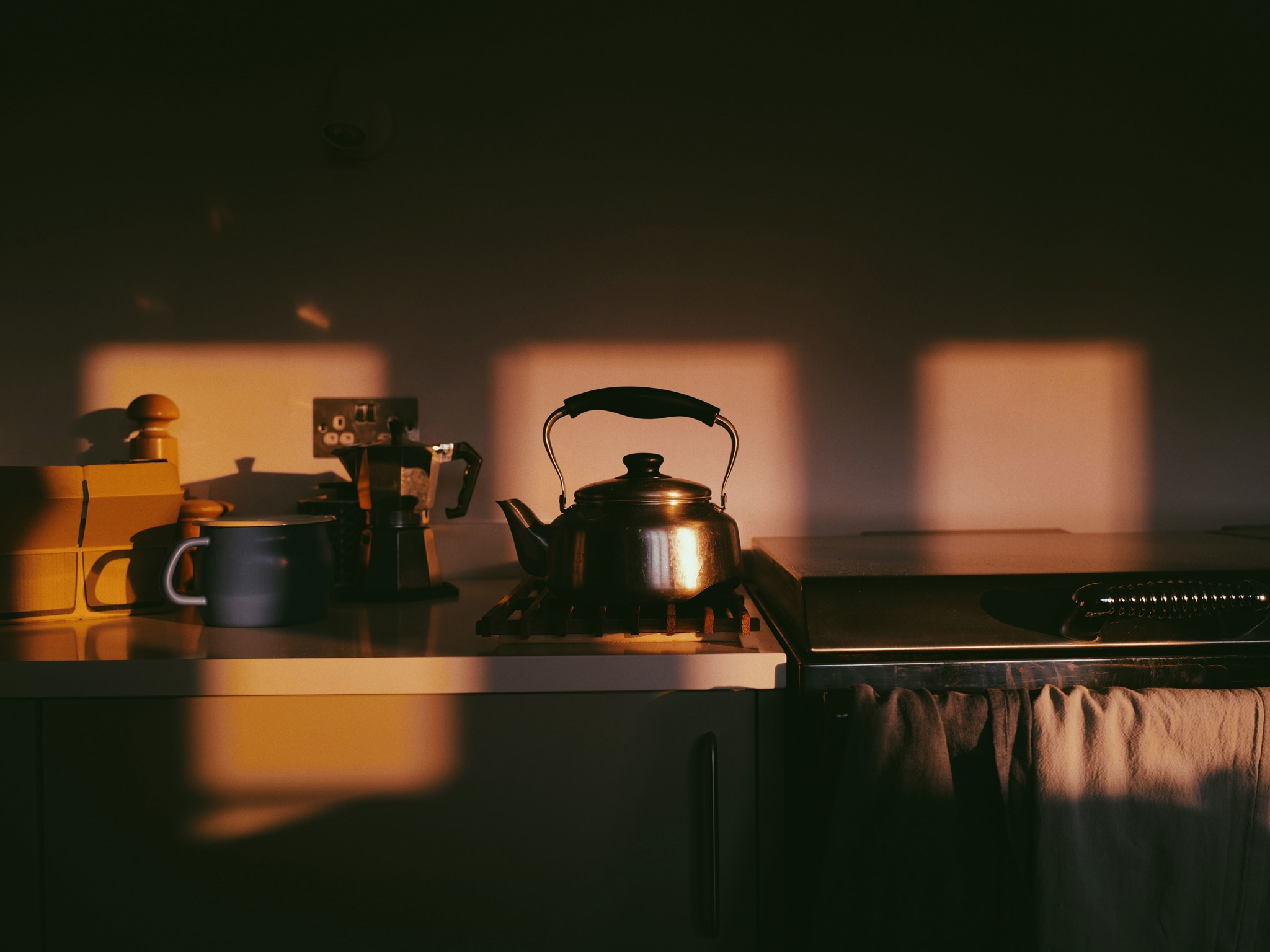 A kettle in a kitchen in the morning light.