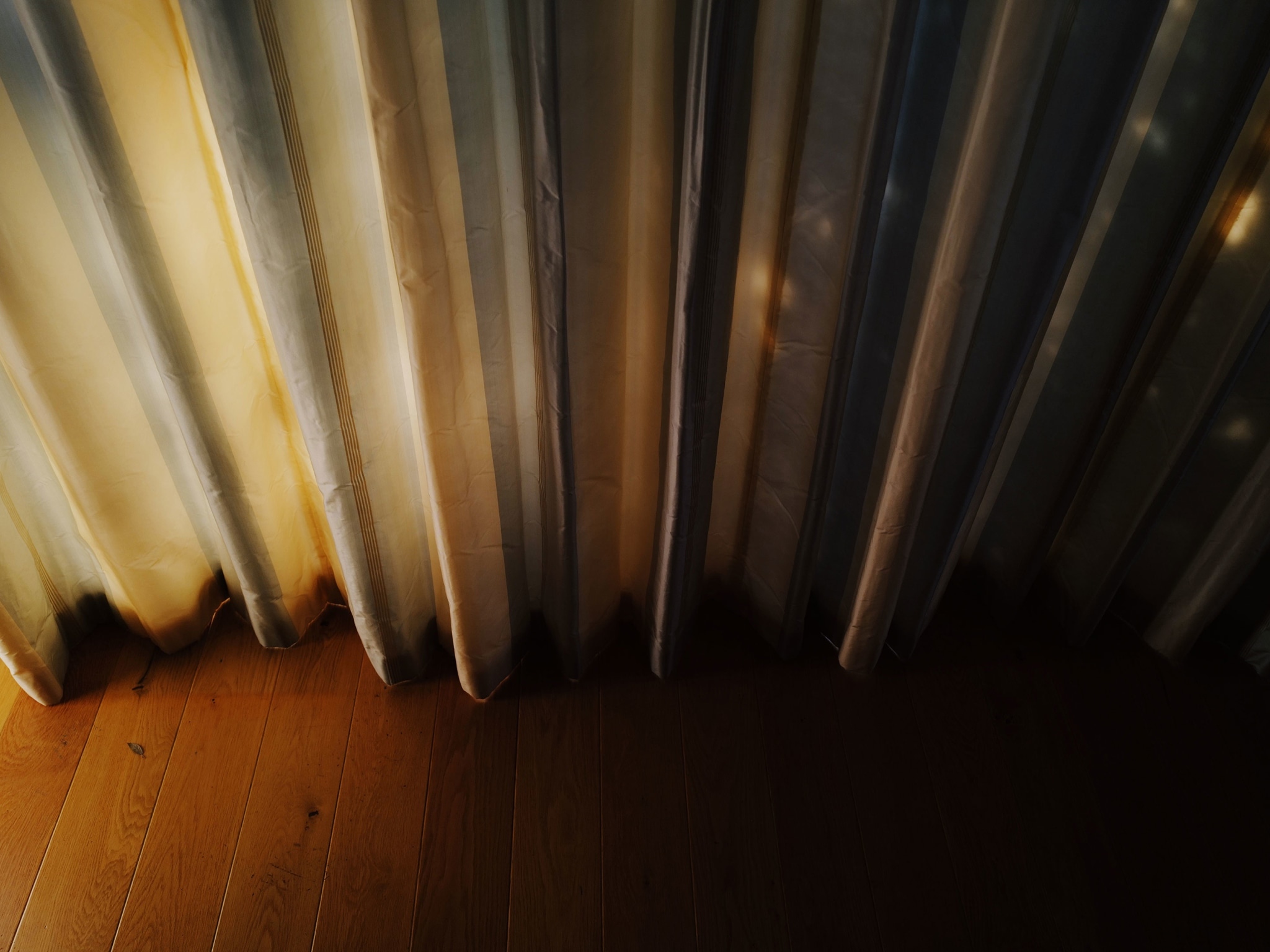 Curtains with sunset light on them.