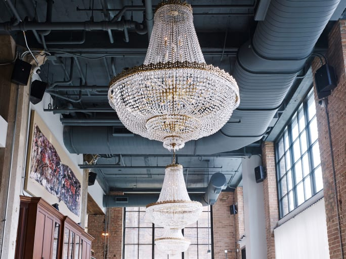 Chandeliers hanging from a high ceiling.