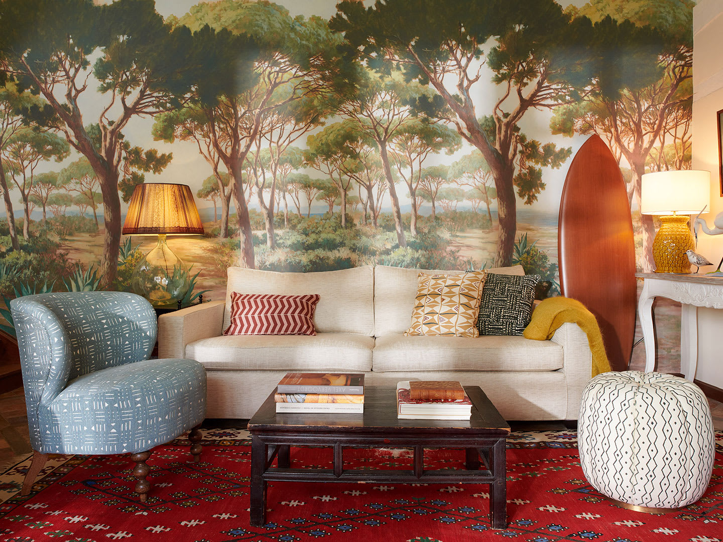 A lounge interior with forest wallpaper.