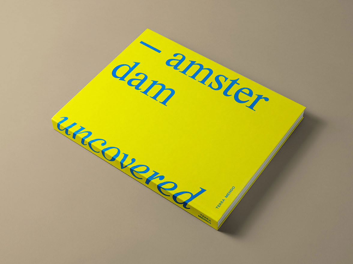 A yellow book with blue type.