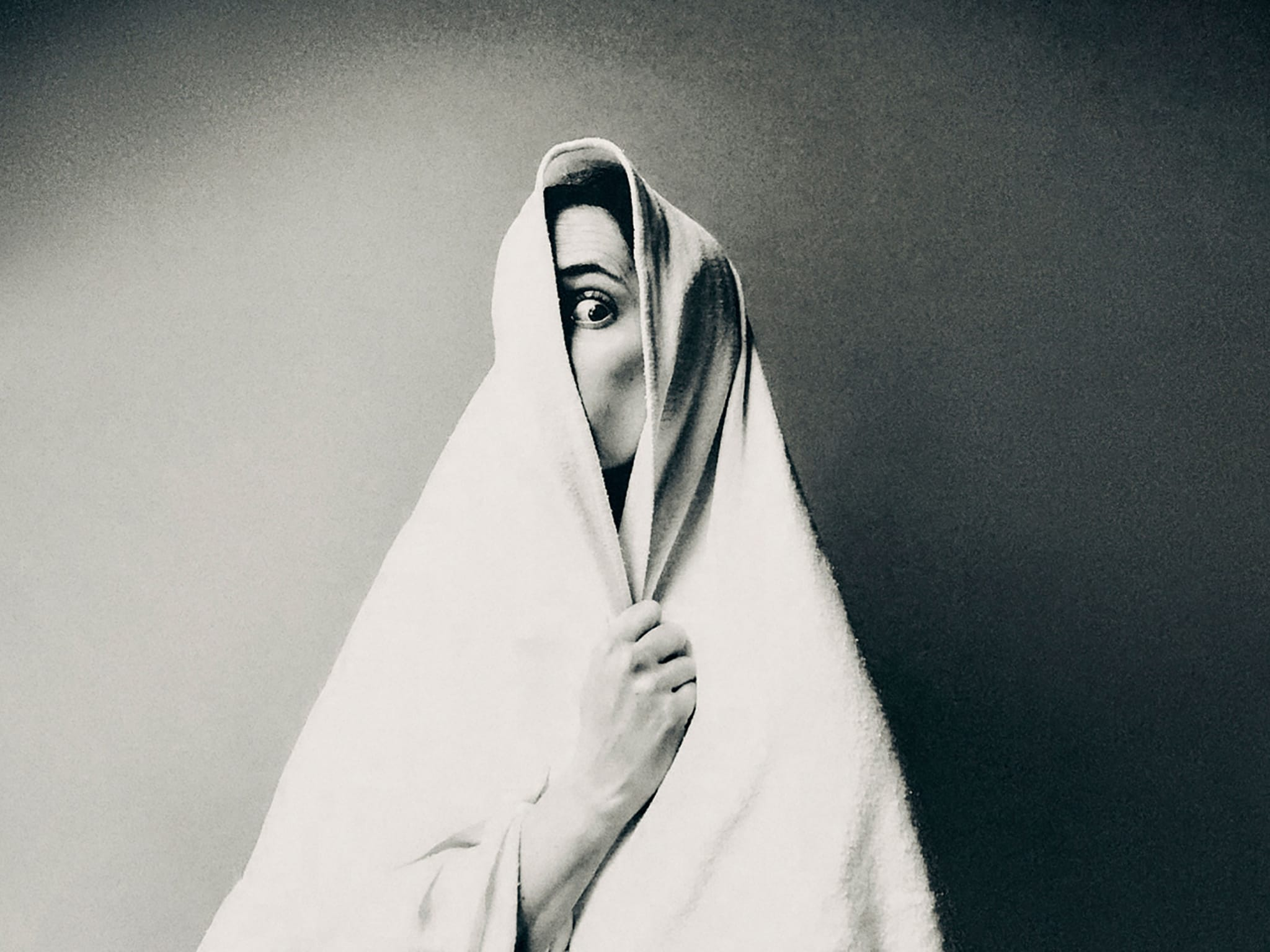 woman wrapped in a white blanket