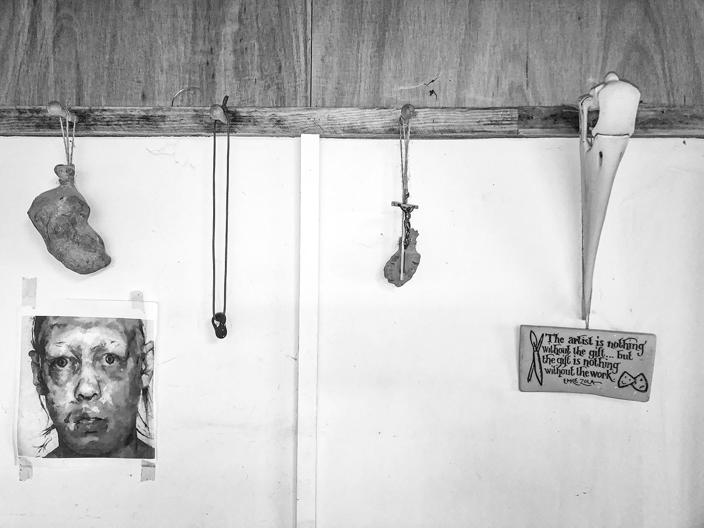 A wall with various objects hanging on it.