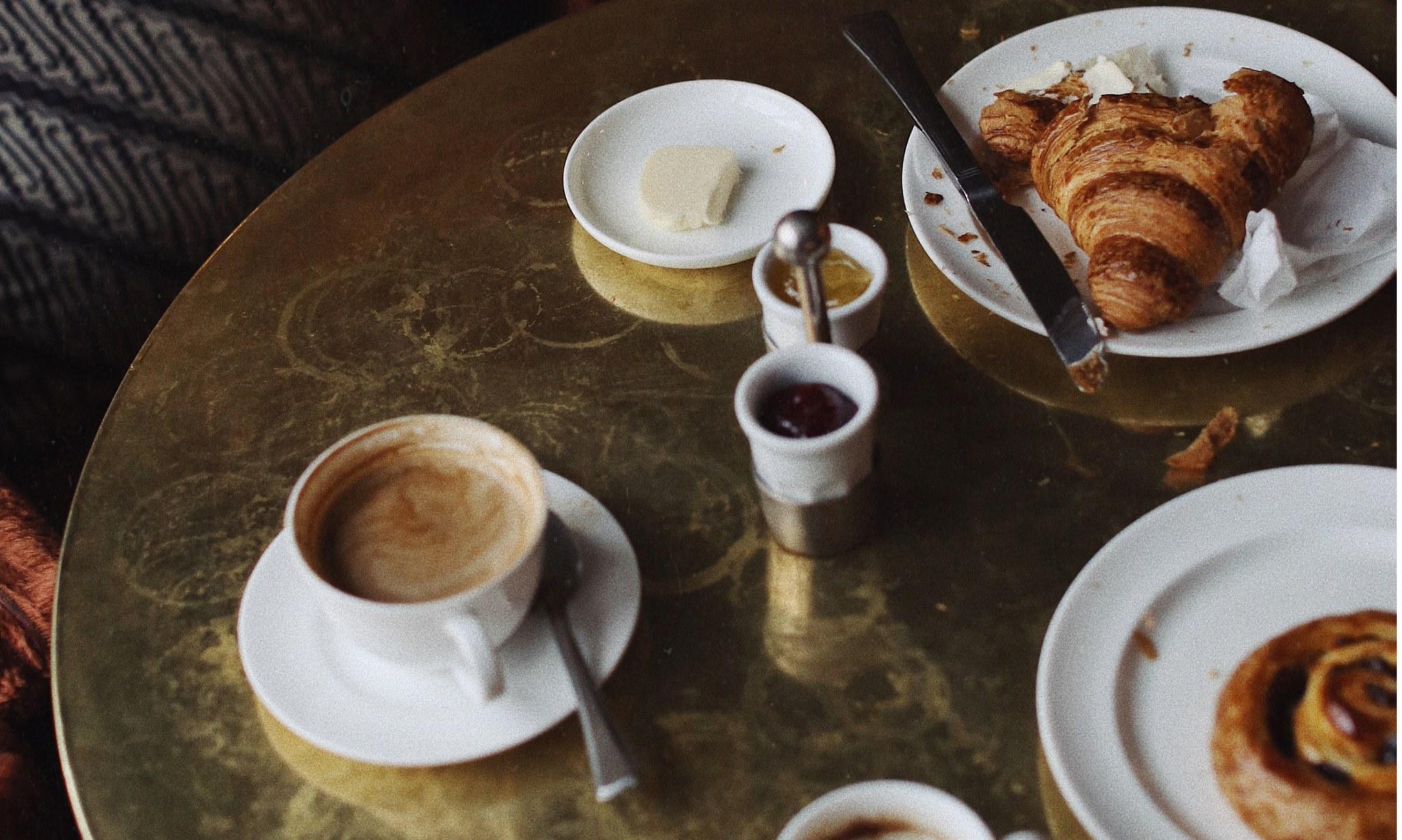 A half eaten breakfast on a table.