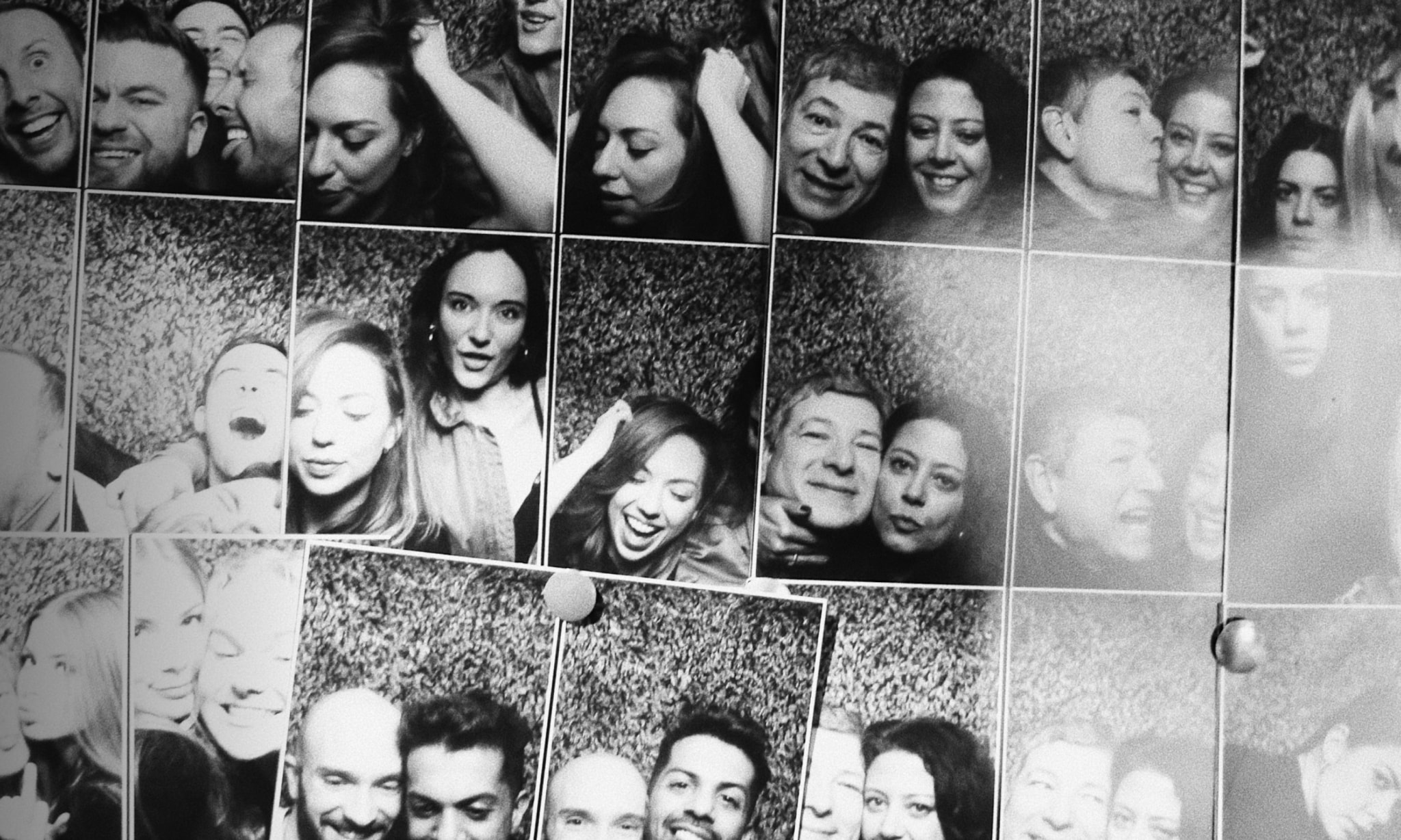 A selection of black and white photobooth photos of people having a good time.