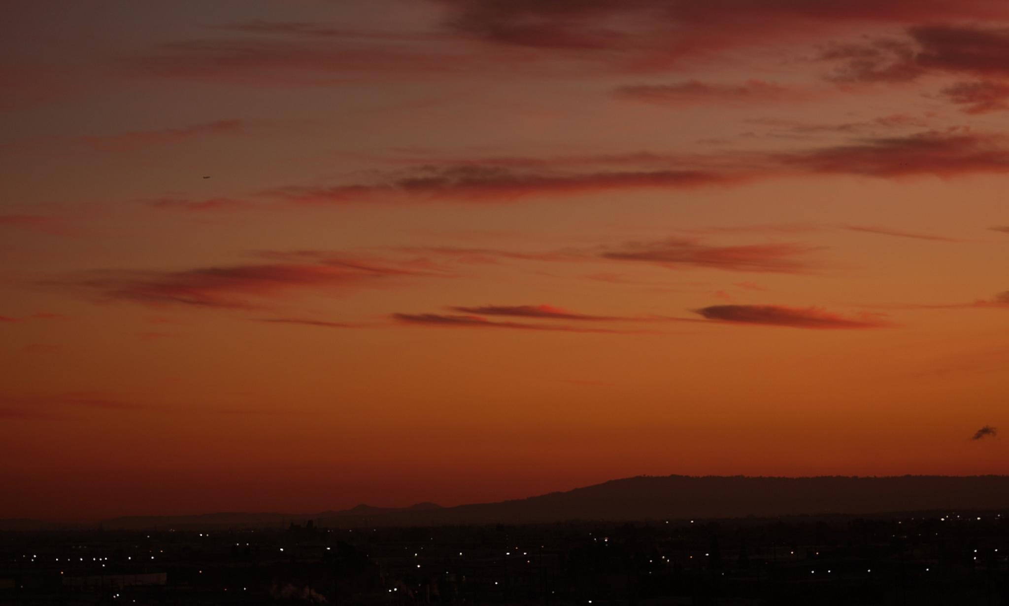 An orange evening sky at sunset.